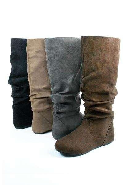 Microsuede flat boots. Low heeled boot features slouchy shaft in faux suede  with a rounded
