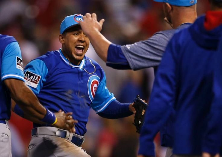 Fly the W! Cubs celebrate after scoring a season-high 17 runs in their win against the Phils. (Laurence Kesterson/AP)  8.26.2017 -- Cubs Photo Stream | MLB.com