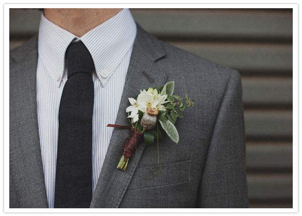 Nice boutonniere w/ white chincherinchee & a berry sprig wrapped in leather