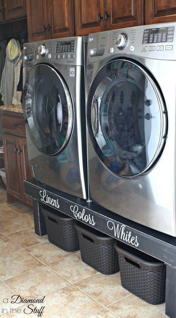 Create a washer and dryer pedestal to organize laundry baskets underneath!