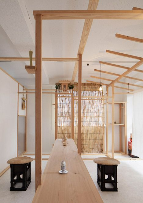 Wooden posts and beams frame displays at this Tokyo shop.