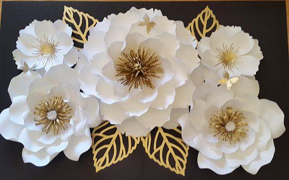 Flores de papel rosa, crema y oro bebé. Este listado incluye 1 x - flor grande - 16 pulgadas 2 flores medianas - 14 pulgadas 2 pequeñas flores 10 pulgadas 4 hojas de OPCIONAL 2 hojas de monstera enmarcado - 8 por 10 pulgadas Enviar una solicitud de orden de encargo con