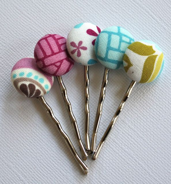 While I like this idea of covering buttons in fabric and making hairpins of them, I could use some of my vintage buttons too!!!