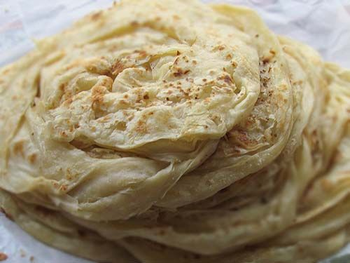 malabari parantha is out of this world! don't be fooled by it's flaky light look. you'll only be able to handle one.
