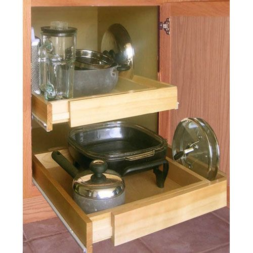 Lower cabinet pull out drawers make finding things easier without sitting on the floor to do it.  I like this one cause it's adjustable and reasonably priced.  Nice kitchen rehab project for an aging parent.