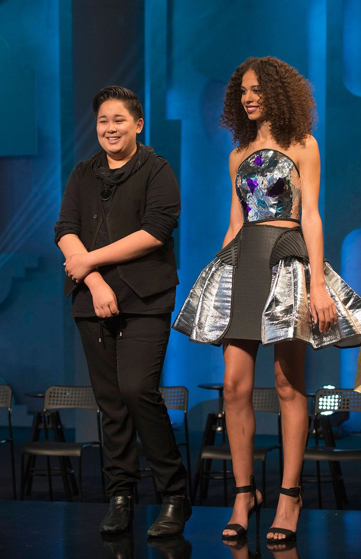 Designer Zachary stands with his winning design from this week of Project Runway Junior.