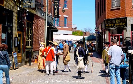 Costumed re-enactors on Marshall Street near The Point in historic downtown Boston - that's the Millennium Bostonian Hotel in the background, with Haymarket in front.