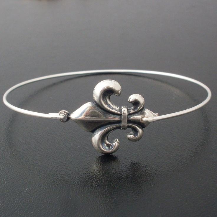 Fleur de Lis Bangle Bracelet - Silver - Lily Flower Bangle - Silver Fleur de Lis Jewelry. $14.95, via Etsy.