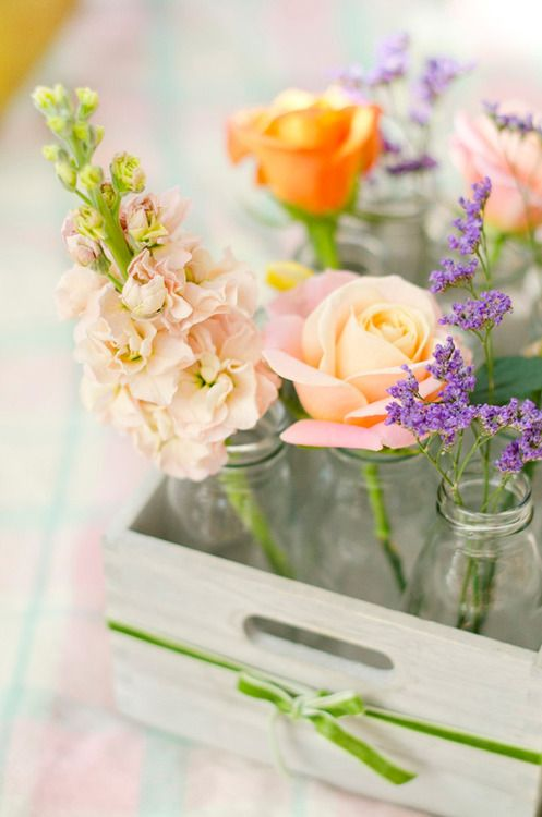 Put a little vase at every place setting, with a beautufl flower in it.  Happy Spring!