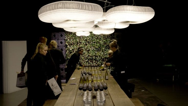 THORS Mosaic, an 8 meter long table made from reclaimed wood from decommissioned danish harbours. Lamps by Molo design. #longtable #conferencetable #sustainablefurniture #antiquewood