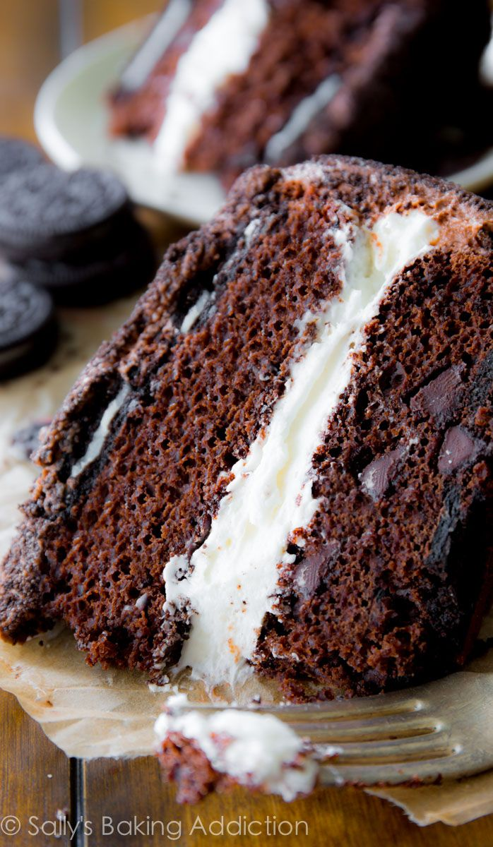 Oreo Layer Cake - complete with a thick Oreo cream filling, chocolate frosting, and two layers of Oreo Cookies. A chocolate lovers dream!