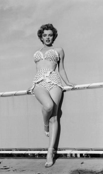 1950s: Marilyn Monroe wearing a 2-piece polka dot bathing suit.