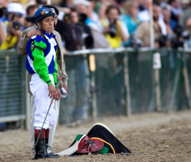 Edgar Prado watches sadly as Barbaro is treated on the track. (Preakness Stakes 2006). So much about his face makes me want to cry.