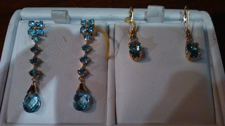 On the left side in this pic, blue topaz dangle earrings with eighteen total stones.