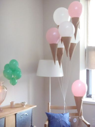 "Add craft paper ""cones"" to helium balloon ""ice cream scoops"". This was from a pickles and ice cream themed baby shower, but it would also be a great decoration for a birthday party."