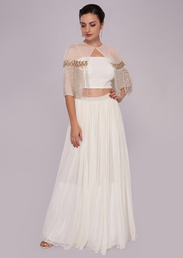 123b40dbd0f White georgette skirt with crop top blouse and tassel embroidered cape only  on Kalki