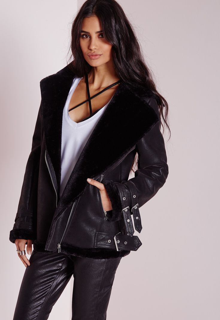 This style is borrowed from the boys, but will look so much better on us. In a totally fierce black hue this pilot style beaut with exposed silver zip fastening and pocket feature will ensure all eyes are on you. With shearling finish to th...