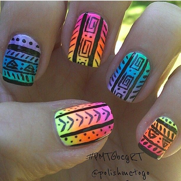 Tribal nails with alternating rainbow gradient colors, purple, blue, green and pink, orange, yellow, black detail tribal design, free hand nail art