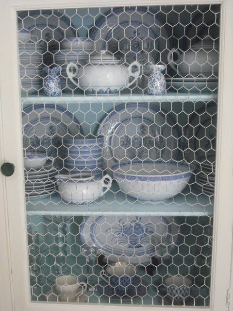 Dining Hutch with blue and white dishes, chicken wire.