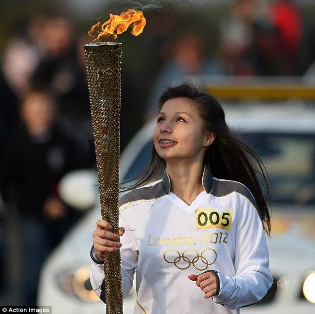 Awe: British table tennis player Vicki Smith carries the Olympic torch