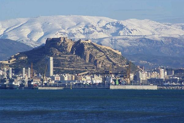 Alicante, Spain with snow on the mountains.