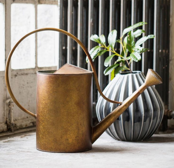 A great Danish designed Zinc watering can with a copper finish.This Danish designed watering can has a lovely rustic copper finish. It has great proportions to be truly functional, whilst adding a stylish, contemporary feel to any garden. It would look great haning from a hook on the shed, used as a planter or would make a great gift for any discerning gardener.Zinc25cm x 15 cm