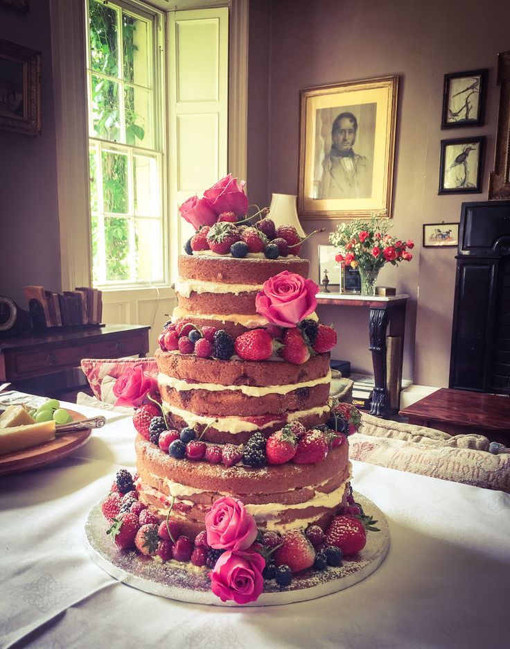 A naked wedding cake looks perfect in the beautiful drawing room at Roundwood House, Mountrath, Co. Laois. www.kellylou.com