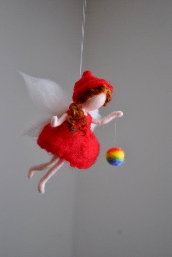 This is a Waldorf inspired piece made of wool by the needle-felting technique. Its been created to provide a peaceful and harmonious image that communicates with the soul through its colors, textures, forms and energy. Doll: 4.5in. SHIPPING: Since shop-home is located in Montréal,