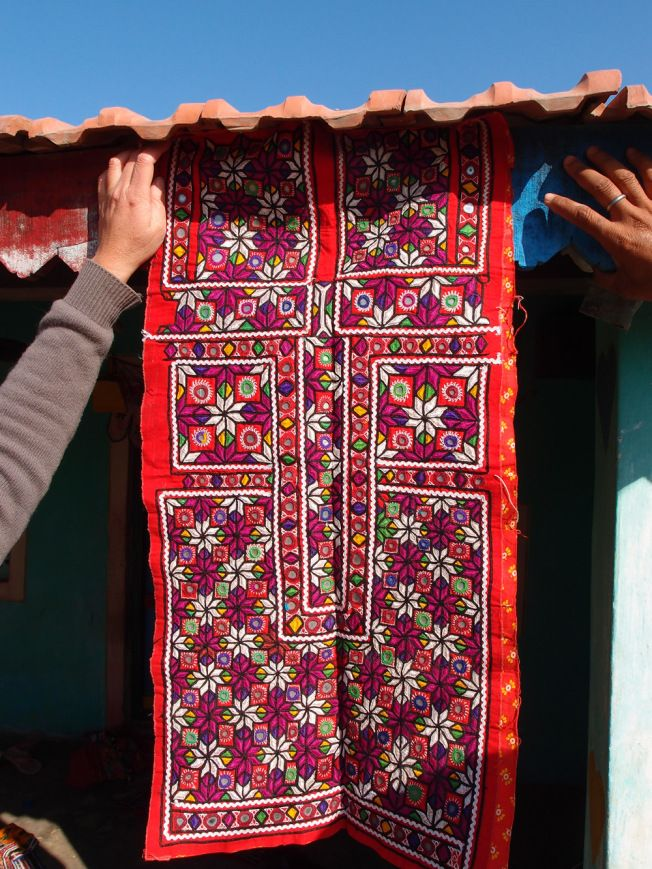 "Meghwal are known for pakko embroidery, which literally means ""solid"" – and you can see how almost every inch of the fabric is covered with stitching. The most common stitches are chain, double buttonhole, stain and fly, supplemented with mirrors, tassels and pompoms."