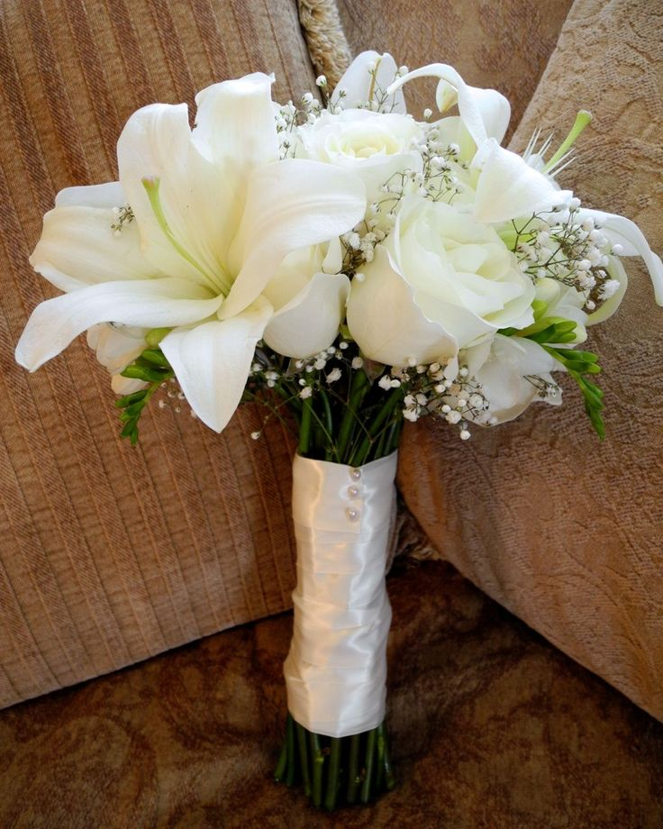 white cream bouquet | We did a very classic all white bouquet with roses, lilies, freesia ...