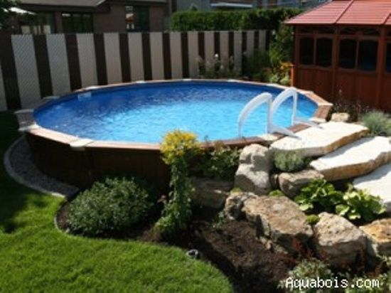 Fabulous landscaping around an above ground pool. @ Home Design Ideas