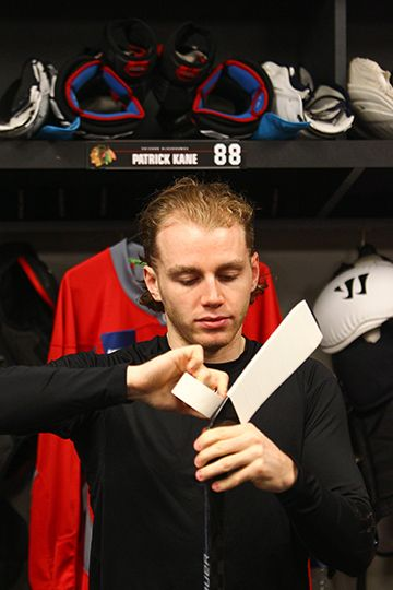 Patrick Kane tapes his stick before morning skate in Nashville.