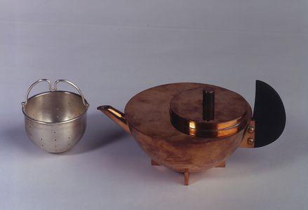 Marianne Brandt. Tea infuser, Model No. MT 49, Dessau. 1927. Tombac, ebony, silver. overall: 7.8 cm x 15.1 cm x 10.1 cm. Neue Galerie New York