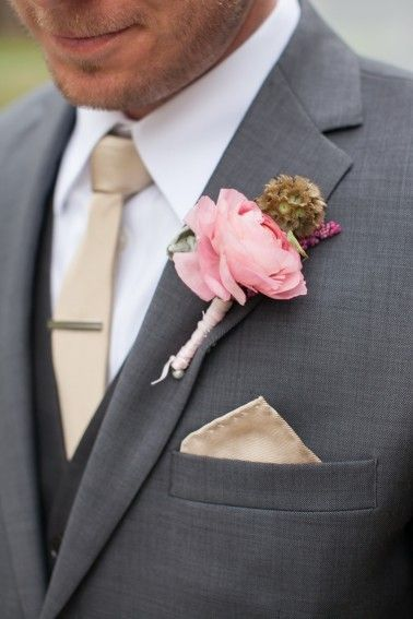 LOVE the groom's dark gray suit, gold tie and blush pink boutonniere!  ~  we ❤ this! moncheribridals.com