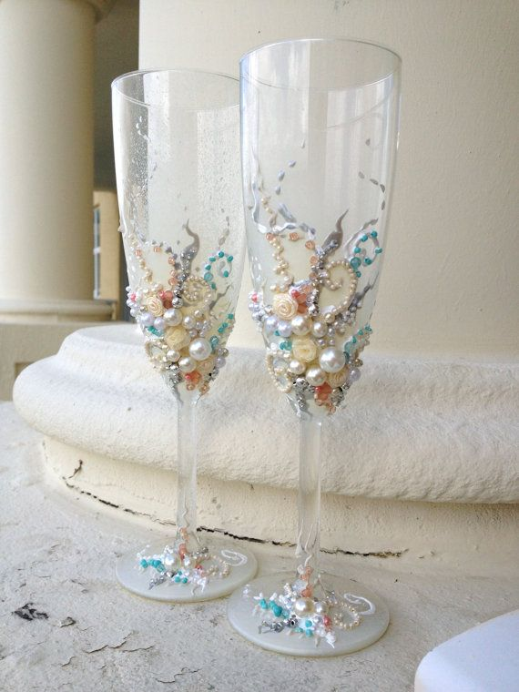 Beautiful wedding champagne glasses in blush pink, ivory, silver and turquoise, elegant toasting flutes with pearls and roses