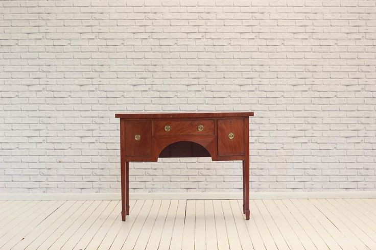 An Edwardian mahogany sideboard, single drawer flanked by 2 cupboards