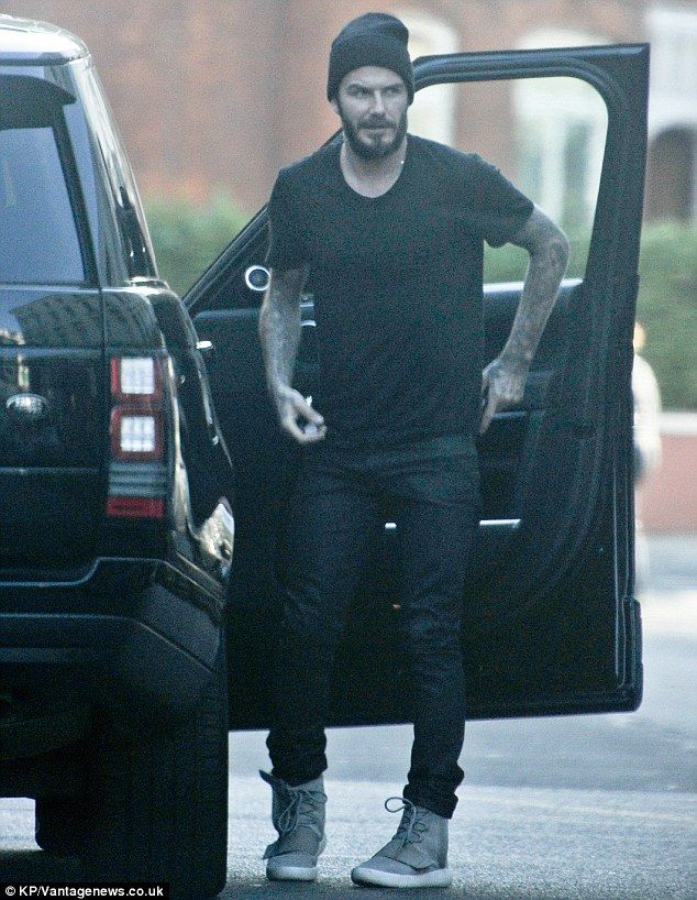 Time for fun and games: David Beckham, wearing a pair of Kanye West-designed Yeezy trainer...