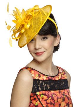 Tilt the End of Time Fascinator. Some will say their favorite timeless fashions are simple black dresses or smooth satchel bags, but to you, its unique looks like this canary-yellow hat that will forever remain your most cherished piece! #yellow #wedding #modcloth