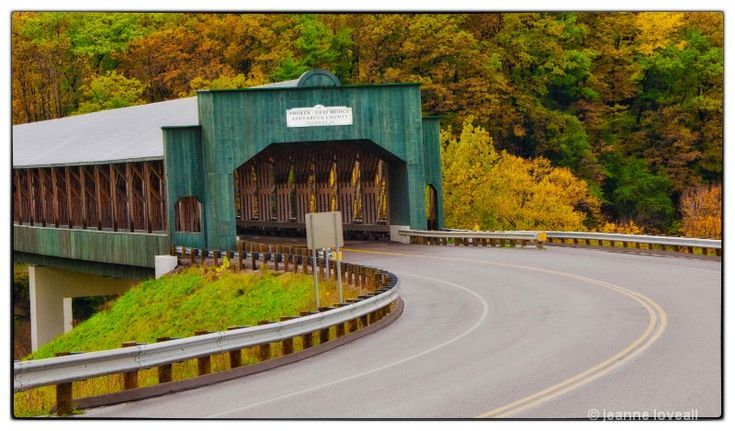 The newest bridge of Ohio's Ashtabula County covered bridges is the longest covered bridge in the United States.  It is 613 ft. long and has a life expectancy of 100 years.  It is named after John Smolen, engineer and strong advocate for preserving the covered bridges of Ashtabula County.