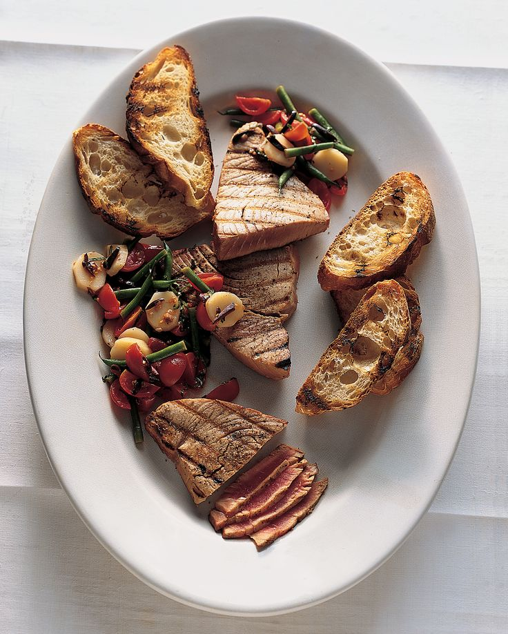 15 Fresh Tuna Recipes That Are Ready in a Flash | Martha Stewart - High-quality fresh tuna requires almost no effort in the kitchen -- just a quick sear in a hot pan or brief turn on the grill. It's also delicious served raw and makes a spectacular burger. Here are our favorite recipes showcasing the tasty fish. #tunarecipe #tunasteak