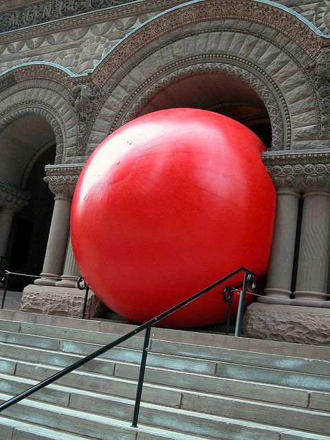 """RedBall Project by Kurt Perschke who says, """"As RedBall travels around the world, people approach me on the street with excited suggestions about where to put it in their city. In that moment the person is not a spectator but a participant in the act of imagination. That invitation to engage, to collectively imagine, is the true essence of the RedBall Project."""" photo of LaSalle Bridge, Chicaago/Rex Features via telegraph.co.uk #RedBall_Project #Kurt_Perschke #telegraph_co_uk"""