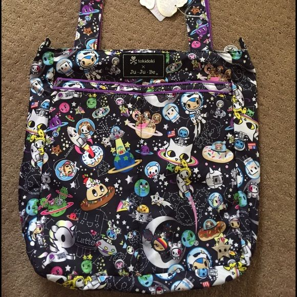 Jujube Tokidoki Space Place Be Light NWT Space Place Be Light diaper bag/purse/tote. Has top zipper, inside pocket, & 2 front pockets. Lots of Sandy print placement. tokidoki Bags Baby Bags