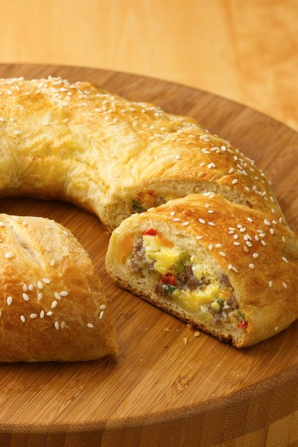 Breakfast bake with warm flaky crust around fluffy eggs and sausage!