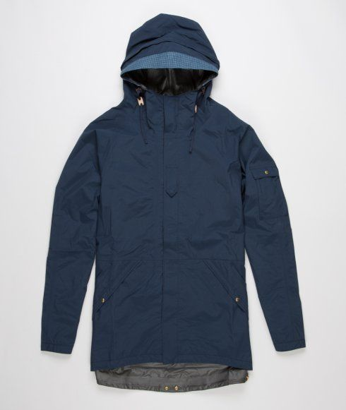 2.5L Nomad Jacket from Visvim. Constructed in Japan from a 2.5L Gore-tex fabric. Featuring two slanted front pockets with press stud closure, adjustable hood, cuffs and waist, zip through front with press stud closure and inside zip pocket. Finished with a small pocket on the left arm. Compatible with the insulator down vest from Visvim.
