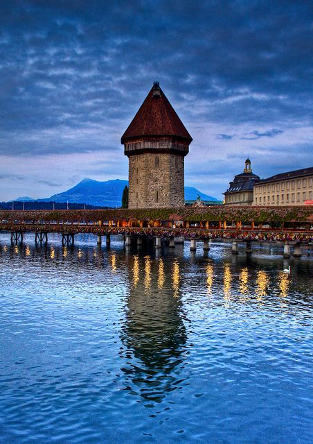 Bridge and former prison tower spanning the beautiful old and new town of Lucerne Switzerland