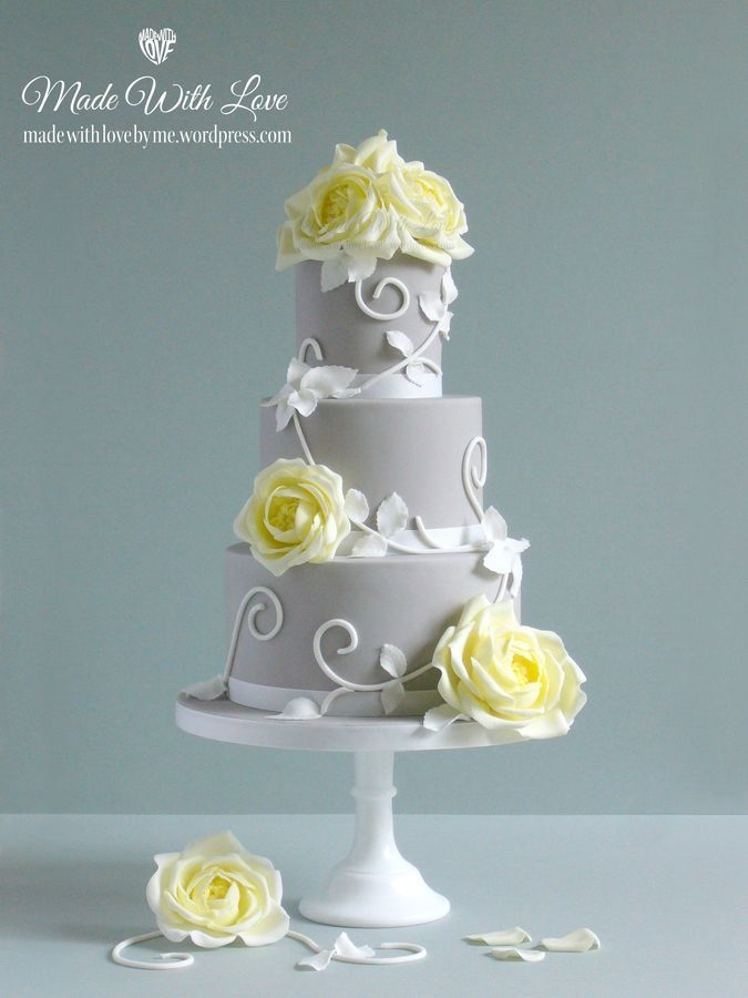 Traditional Wedding Cake with a modern twist: sugarpaste flowers, leaves & swirls are in flower paste/gumpaste