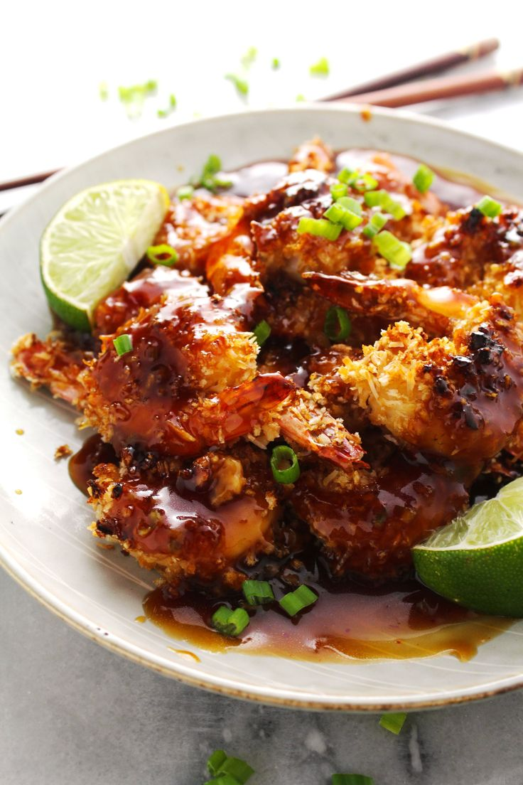 Honey Lime Baked Coconut Shrimp! HONEY LIME BAKED COCONUT SHRIMP. Honey. Lime. Baked. Coconut. Shrimp. I basically look like the heart-eyes emoji as I stare and drool at this delicious, perfectly crunchy, kinda healthy, coconut shrimp drenched in this honey lime garlic sauce. BAKE IT AND MAKE IT! #honey #garlic #shrimp #baked #coconut