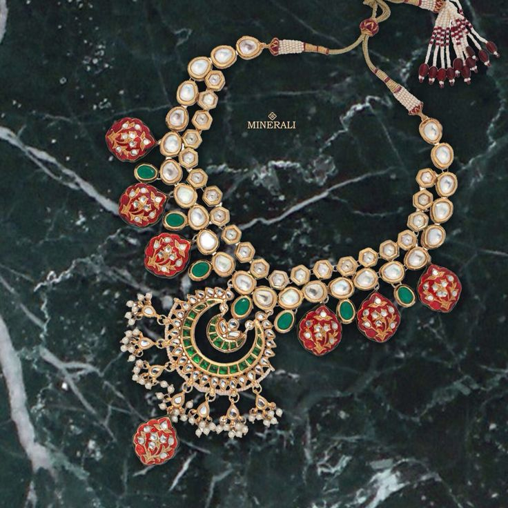 A brilliant design infused with green and red colours studded with kundans is a must have piece. By TAD accessories, at Minerali. #minerali_store #tad #accessories #love #accessorize #designerjewellery #weddingjewellery #jewellery #necklace #neckpiece #design #fashion #linkingroad #bandra #minerali