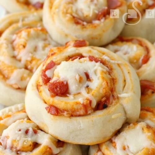 These Pizza Pinwheels from Butter with a Side of Bread are the perfect appetizer and party recipe that your friends and family will love!