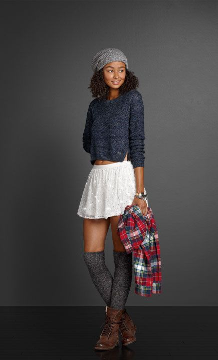 Knee socks and a slouchy beanie give your look just the right amount of 90s attitude.